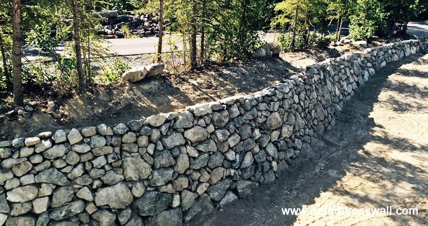 Retaining walls by rock landscaping anchorage alaska for Installing river rock landscaping